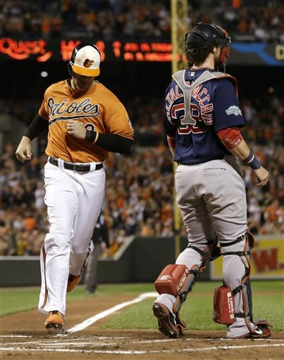 Baltimore Orioles' Chris Davis, left, jogs past Boston Red Sox catcher Jarrod Saltalamacchia for a run on a single by Manny Machado in the second inning of a baseball game in Baltimore, Saturday, Sept. 29, 2012. (AP Photo/Patrick Semansky)