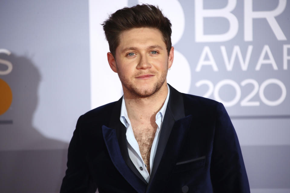 Niall Horan poses for photographers upon arrival at the Brit Awards 2020 in London, Tuesday, Feb. 18, 2020. (Photo by Joel C Ryan/Invision/AP)