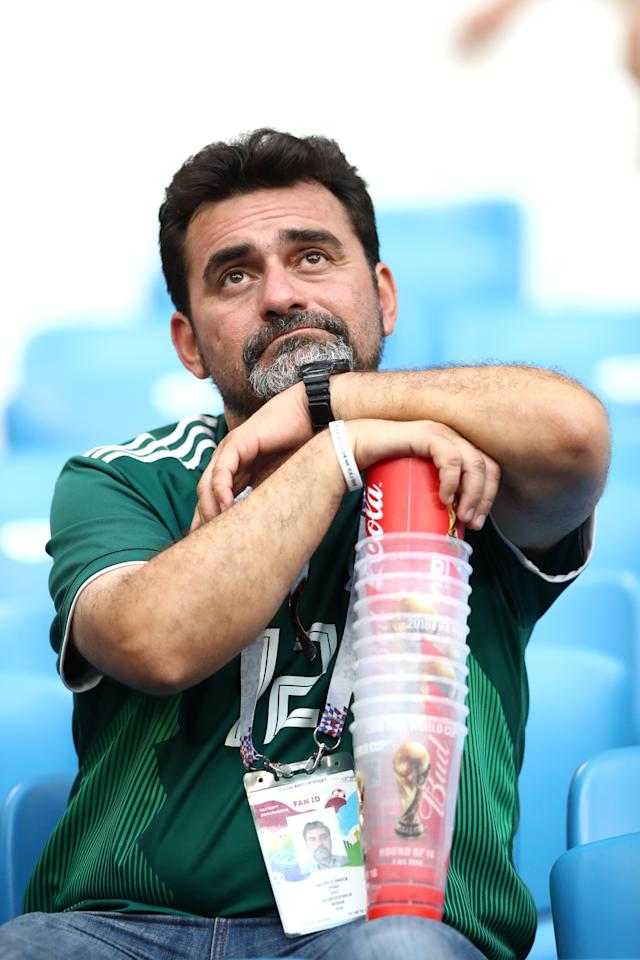 <p>A Mexico fan looks dejected following his sides defeat in the 2018 FIFA World Cup Russia Round of 16 match between Brazil and Mexico at Samara Arena on July 2, 2018 in Samara, Russia. (Photo by Ryan Pierse/Getty Images) </p>