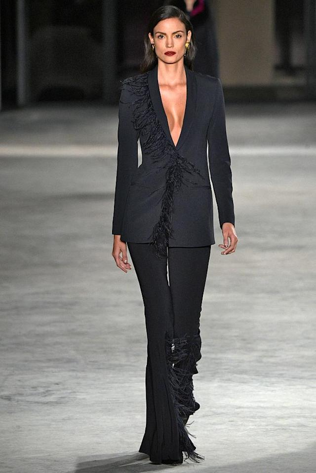 <p>Model wears a black fringe-detailed pantsuit at the fall 2018 Cushnie et Ochs show. (Photo: Getty Images) </p>