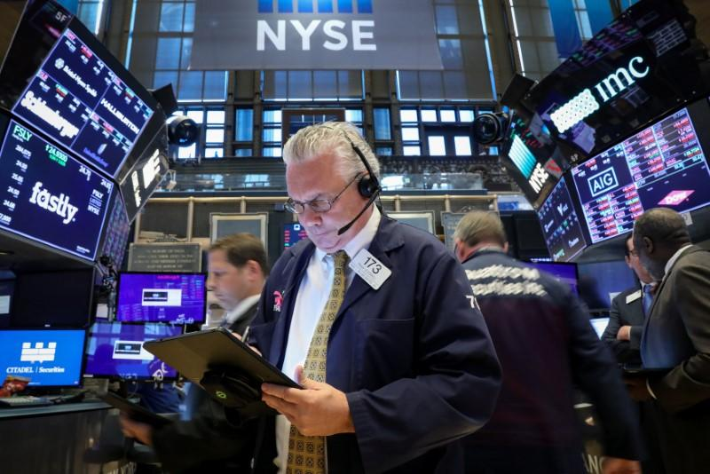 FILE PHOTO: Traders work on the floor at the New York Stock Exchange (NYSE) in New York, U.S., May 20, 2019. REUTERS/Brendan McDermid