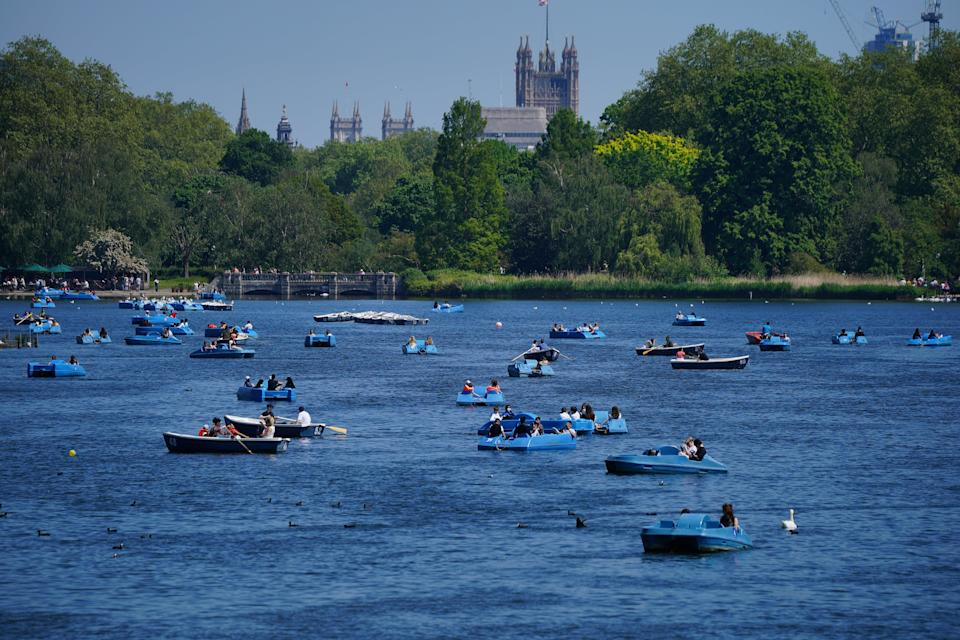People ride pedalos on the Serpentine in Hyde Park, London (PA Wire)
