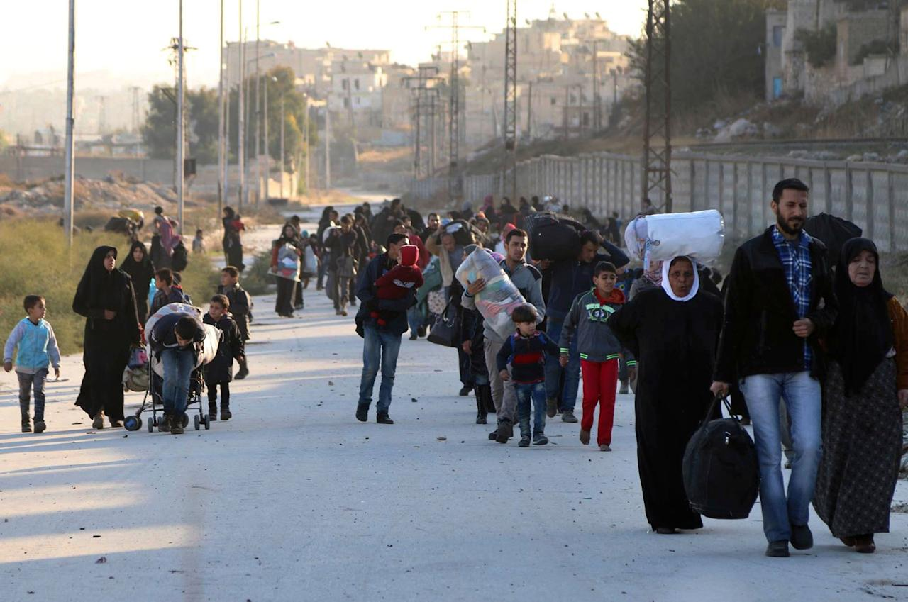 <p>In this Sunday, Nov. 27, 2016 photo provided by the Rumaf, a Syrian Kurdish activist group, which has been authenticated based on its contents and other AP reporting, shows people fleeing rebel-held eastern neighborhoods of Aleppo into the Sheikh Maqsoud area that is controlled by Kurdish fighters, Syria. With Syria's Russian-backed military appearing close to seizing total control of Aleppo, U.S. officials concede they have little to no chance of securing a diplomatic breakthrough to halt the civil war in President Barack Obama's last weeks in office. (The Rumaf via AP) </p>