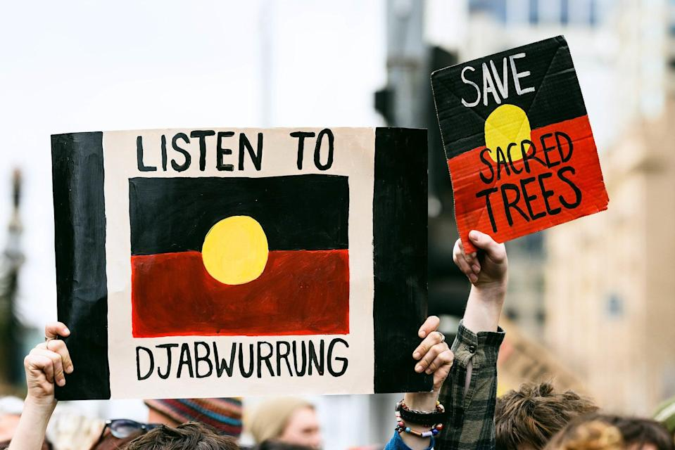 Djab Wurrung protesters hold placards up at Parliament House Canberra in September 2019 (Julian Meehan)
