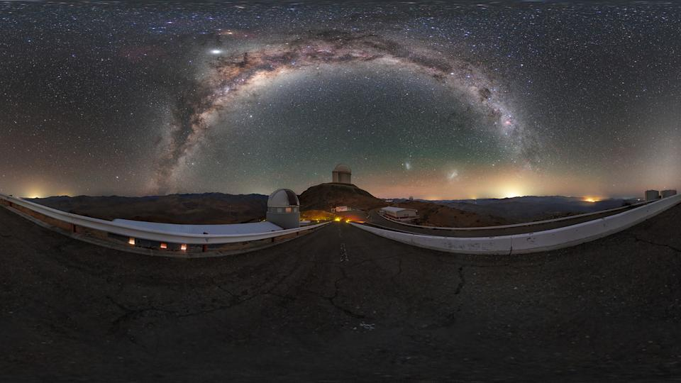 The arc of the Milky Way galaxy shimmers over the La Silla Observatory in Chile in this gorgeous night-sky view by European Southern Observatory (ESO) photo ambassador Petr Horálek. In the center of the image is the ESO 3.6-metre telescope, and to its left is the Swiss 1.2-metre Leonhard Euler telescope. Visible beneath the righthand limb of the Milky Way's starry arc are the Large and Small Magellanic Clouds, two satellite galaxies of the Milky Way. Saturn is visible under the left side of the arc, with Jupiter glowing brightly just above it and slightly to the left.