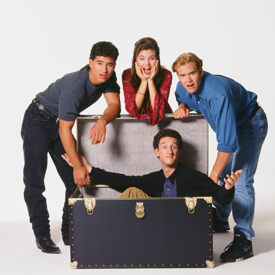SAVED BY THE BELL: THE COLLEGE YEARS -- SEASON 1 -- Pictured: (l-r) Mario Lopez as A.C. Slater, Tiffani Thiessen as Kelly Kapowski, Dustin Diamond as Screech Powers, Mark-Paul Gosselaar as Zack Morris  (Photo by Chris Haston/NBCU Photo Bank/NBCUniversal via Getty Images via Getty Images)