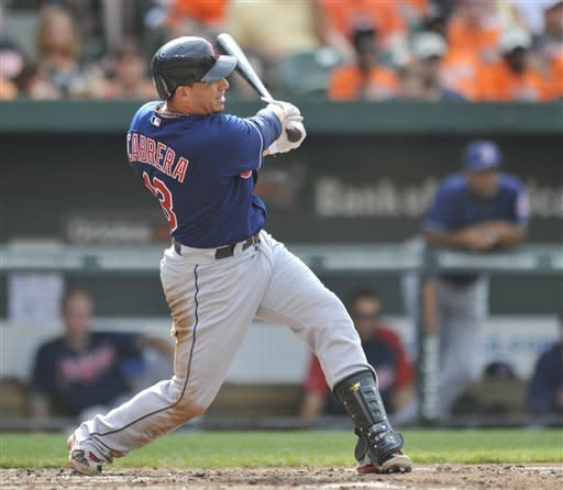 Cleveland Indians' Asdrubal Cabrera hits an RBI single against the Baltimore Orioles during the fourth inning of a baseball game Saturday, June 30, 2012 in Baltimore.(AP Photo/Gail Burton)