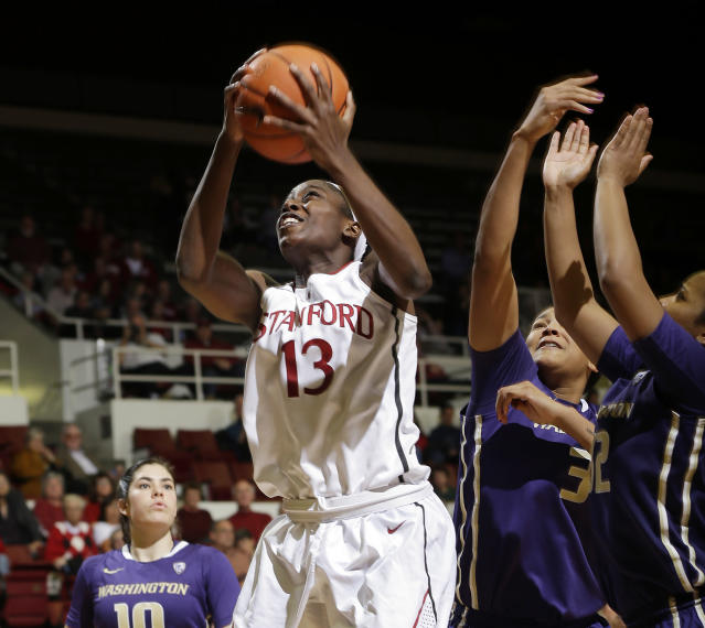Stanford forward Chiney Ogwumike (13) goes up for a layup during the second half of an NCAA college basketball game against Washington on Thursday, Feb. 27, 2014, in Stanford, Calif. Stanford won 83-60. (AP Photo/Marcio Jose Sanchez)
