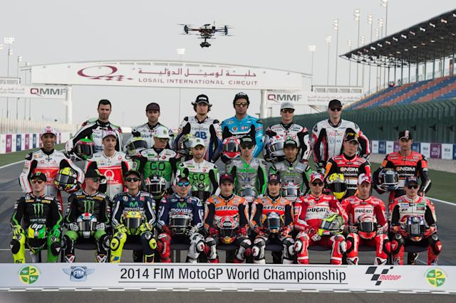 DOHA, QATAR - MARCH 20: The MotoGP riders poses for the official photo in start line on track during the MotoGp of Qatar - Free Practice at Losail Circuit on March 20, 2014 in Doha, Qatar. (Photo by Mirco Lazzari gp/Getty Images)