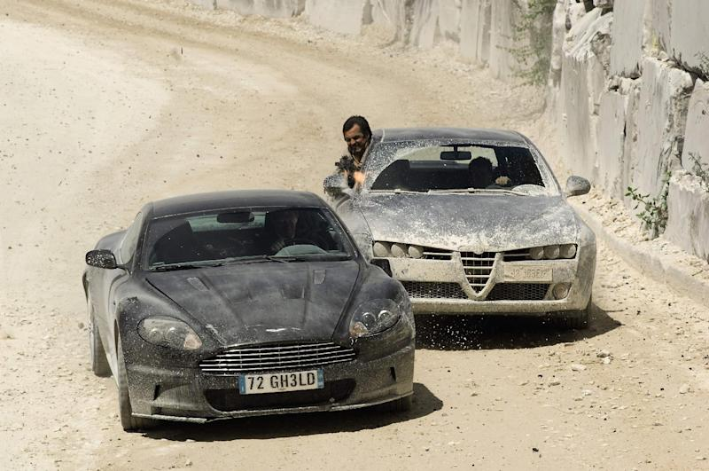 """In this image made available by the auction house Christie's made available  Thursday Sept. 6, 2012  the James Bond Aston Martin being chased by an Alfa Romero in a scene from  the James Bond film Quantum of Solace. The Aston Martin V12 DBS coupe which featured in the James Bond film """"Quantum of Solace"""" is the top attraction at a charity auction marking the 50th anniversary of the first 007 film, """"Dr. No."""" Christie's auctioneers said Thursday Sept. 6, 2012 that the car, a 2008 model, is expected to sell for at least 100,000 pounds ($160,000) at an invitation-only auction on Oct. 5. Proceeds will benefit Barnardo's, a British children's charity. (AP Photo/Danjaq, LLC and United Artists Corporation, Christie's) NO ARCHIVE"""