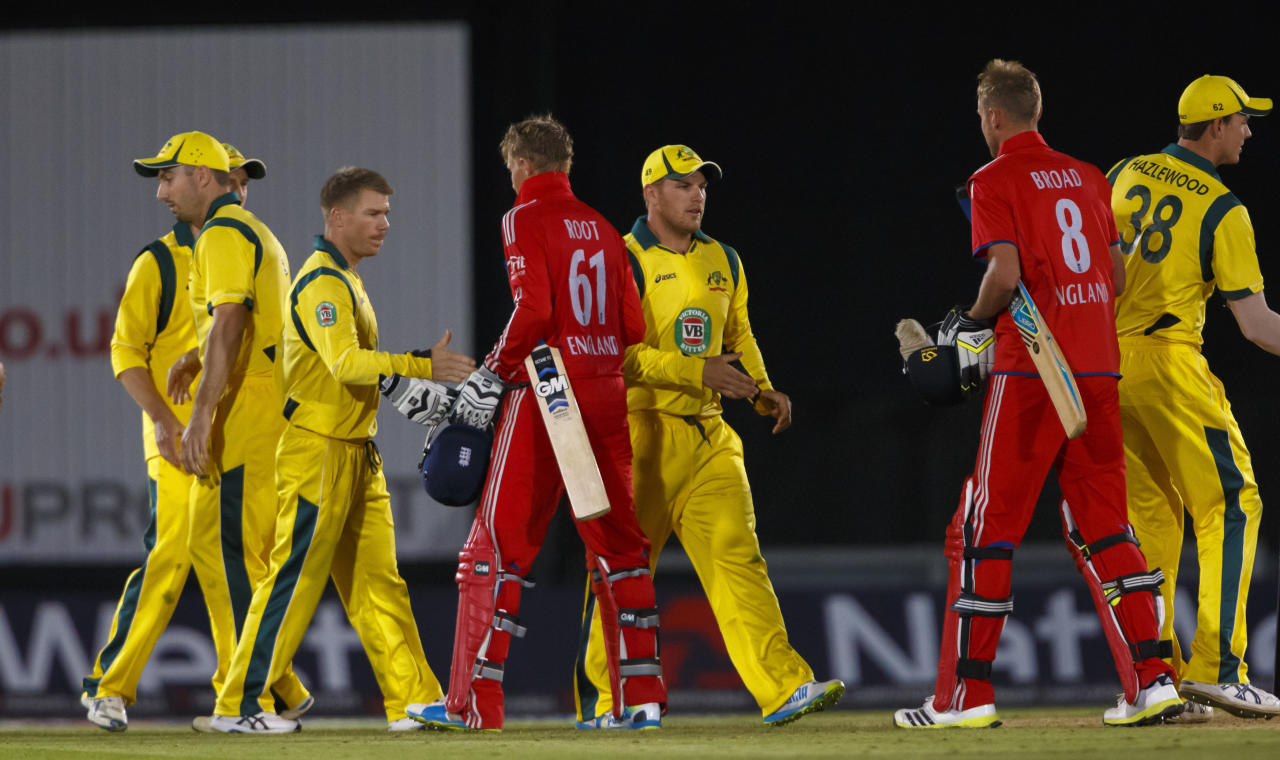 England's Joe Root shakes hands with Australia's David Warner at the close of the International Twenty20 match at the Ageas Bowl, Southampton.