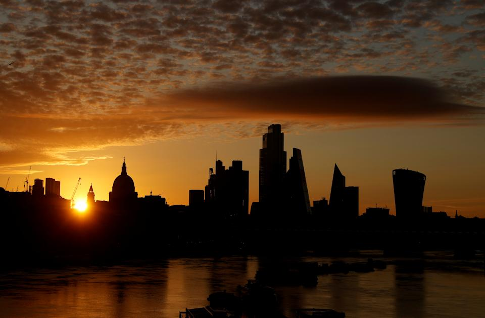 The sun rises behind the skyline of St Paul's Cathedral and the City of London, in London, Britain, August 2, 2020. REUTERS/John Sibley     TPX IMAGES OF THE DAY