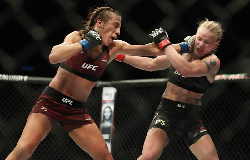 TORONTO, ON- DECEMBER 9 - Valentina Shevchenko, right, trades blows with Joanna Jedrzejczyk at UFC 231 at Scotiabank Arena. Shevchenko would win the UFC Flyweight Championship in Toronto. December 9, 2018. (Steve Russell/Toronto Star via Getty Images)