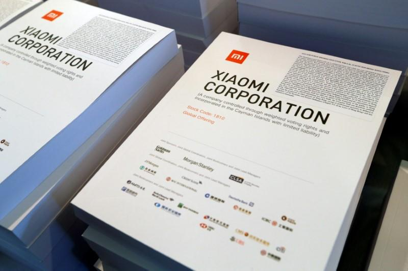 Brochures on the IPO of Xiaomi are showm at a news conference in Hong Kong