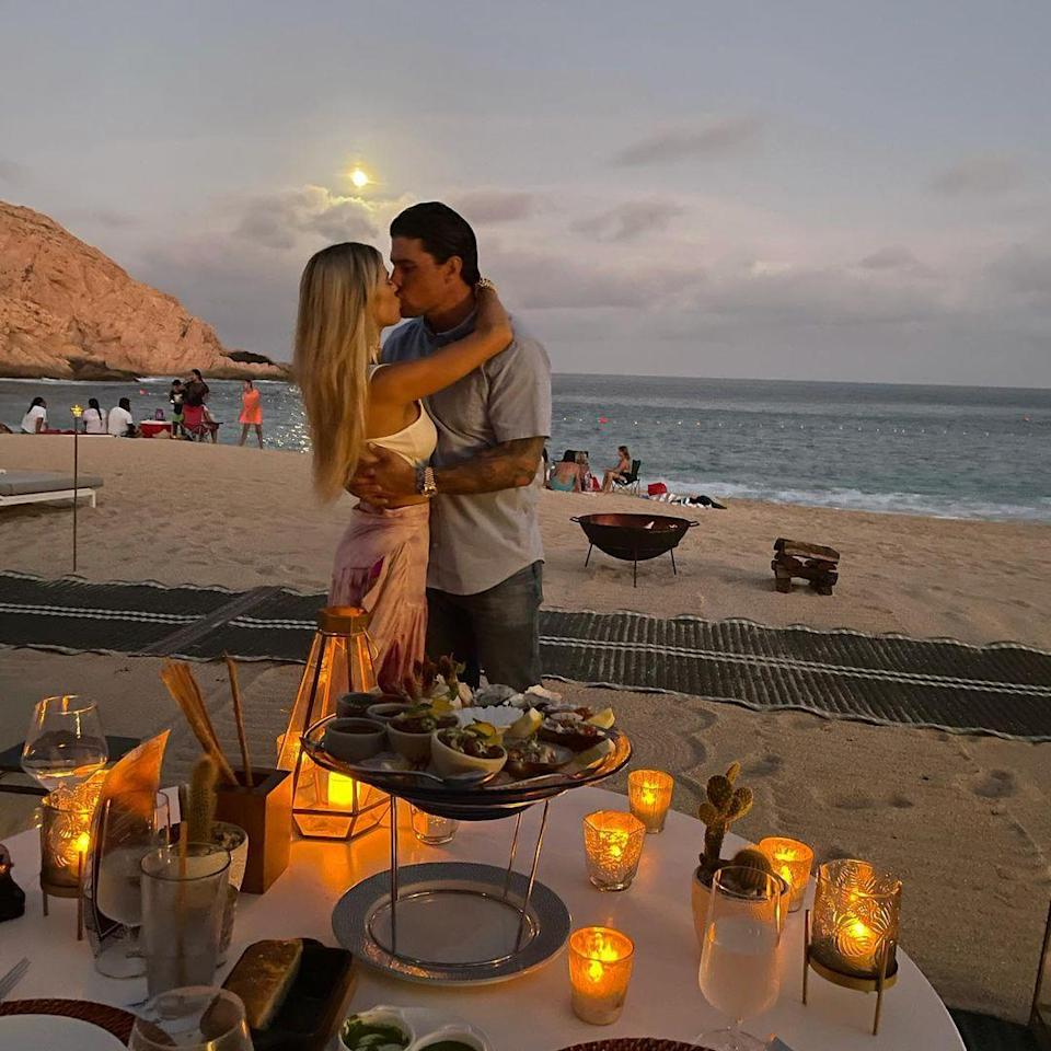 <p>In the slideshow of photos announcing their engagement, the <em>Flip or Flop </em>star shared snaps of the pair enjoying a romantic candlelit dinner in Los Cabos, Mexico. </p>