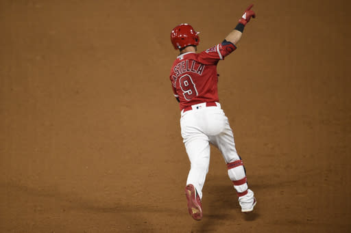 Los Angeles Angels' Tommy La Stella points while running the bases after hitting a two-run home run during the ninth inning of the team's baseball game against the San Francisco Giants in Anaheim, Calif., Monday, Aug. 17, 2020. The Angels won 7-6. (AP Photo/Kelvin Kuo)