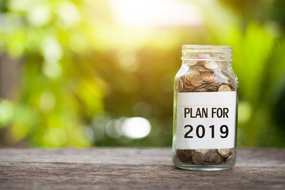 Jar of coins with the words Plan for 2019 on the label.