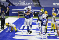 Indianapolis Colts' Trey Burton (80) celebrates a touchdown reception with Jack Doyle (84) during the first half of an NFL football game against the Green Bay Packers, Sunday, Nov. 22, 2020, in Indianapolis. (AP Photo/Michael Conroy)