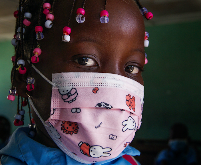 A young girls wearing a face mask on the first day back to school after a coronavirus closure in Maputo, Mozambique - Monday 22 March 2021