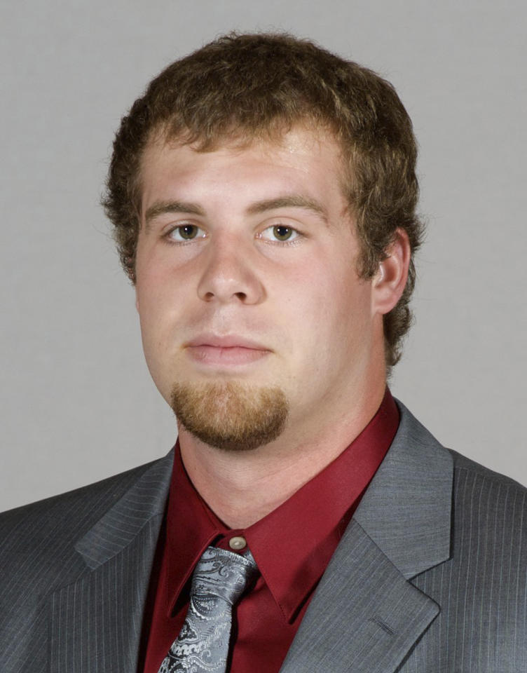 <p>In this undated photo, provided by Southern Illinois University, Jason Seaman, a defensive end for the SIU football team, poses for a photo in Carbondale, Ill. Seaman, now a science teacher at Noblesville West Middle School in Noblesville, Ind., subdued a student armed with two handguns who opened fire inside his classroom Friday, May, 25, 2018. (Photo: Southern Illinois University via AP) </p>