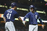 San Diego Padres' Wil Myers, right, and Robbie Erlin (41) celebrate after scoring against the San Francisco Giants during the third inning of a baseball game Tuesday, Sept. 25, 2018, in San Francisco.(AP Photo/Ben Margot)