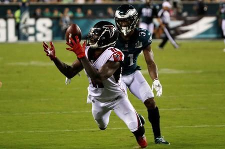 FILE PHOTO: Atlanta Falcons receiver Julio Jones try to make a catch on a long pass in front of Philadelphia Eagles defender Jalen Mills in the third quarter of their NFL football game in Philadelphia