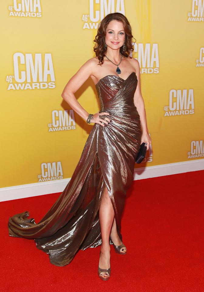 "<p class=""MsoNormal""><span style=""color:black;"">Brad Paisley's wife, ""Nashville's"" Kimberly Williams-Paisley, showed off both her toned arms and legs in a bronze silk gown designed by Romona Keveza. The actress served as a presenter. (11/1/2012)<br></span></p>"