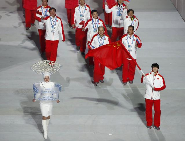 China's flag-bearer Tong Jian leads his country's contingent during the athletes' parade at the opening ceremony of the 2014 Sochi Winter Olympics, February 7, 2014. REUTERS/Lucy Nicholson (RUSSIA - Tags: OLYMPICS SPORT)