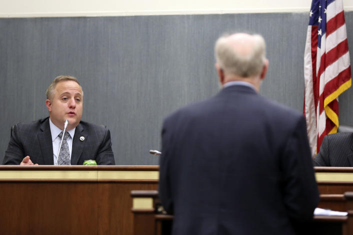 South Carolina state Rep. Russell Fry, R-Surfside Beach, left, asks a question to South Carolina Senior Assistant Deputy Attorney General Don Zelenka during a hearing, Wednesday, April 21, 2021, in Columbia, S.C. Zelenka was testifying about a bill that would add a firing squad to the state's execution methods. (AP Photo/Jeffrey Collins)