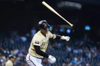 Arizona Diamondbacks' Carson Kelly flips his bat away as he flies out against the Los Angeles Dodgers during the third inning of a baseball game Sunday, Sept. 26, 2021, in Phoenix. (AP Photo/Ross D. Franklin)