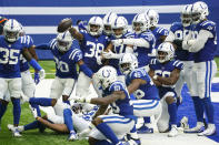 Indianapolis Colts cornerback T.J. Carrie (38) celebrates a touchdown on an interception against the New York Jets in the second half of an NFL football game in Indianapolis, Sunday, Sept. 27, 2020. (AP Photo/AJ Mast)