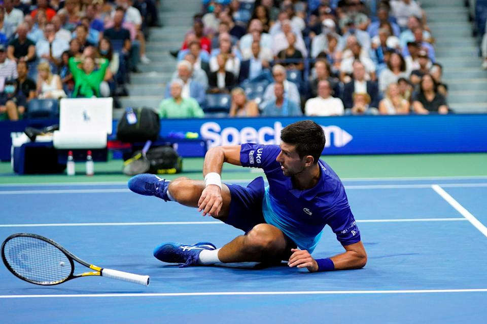 Novak Djokovic lunged, dropped his racket before he hit the court and missed on a return to Matteo Berrettini.