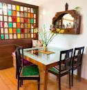 The dining area is cosy with varied shades of wood. Bhakti draws attention to the vintage chairs that lend character to this section.