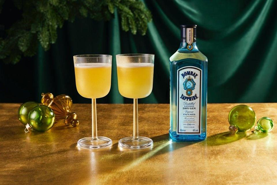 """<p>Put 35ml <a href=""""https://www.bombaysapphire.com/"""" rel=""""nofollow noopener"""" target=""""_blank"""" data-ylk=""""slk:Bombay Sapphire"""" class=""""link rapid-noclick-resp"""">Bombay Sapphire </a>gin, 15ml Benedictine, 25ml fresh lemon guide and 15ml honey syrup (1:1 parts honey to warm water) into a cocktail shaker. Add cubed ice to the top, fasten lid and shake hard for 30 seconds. Strain into glass and garnish with edible gold spray.<br></p>"""
