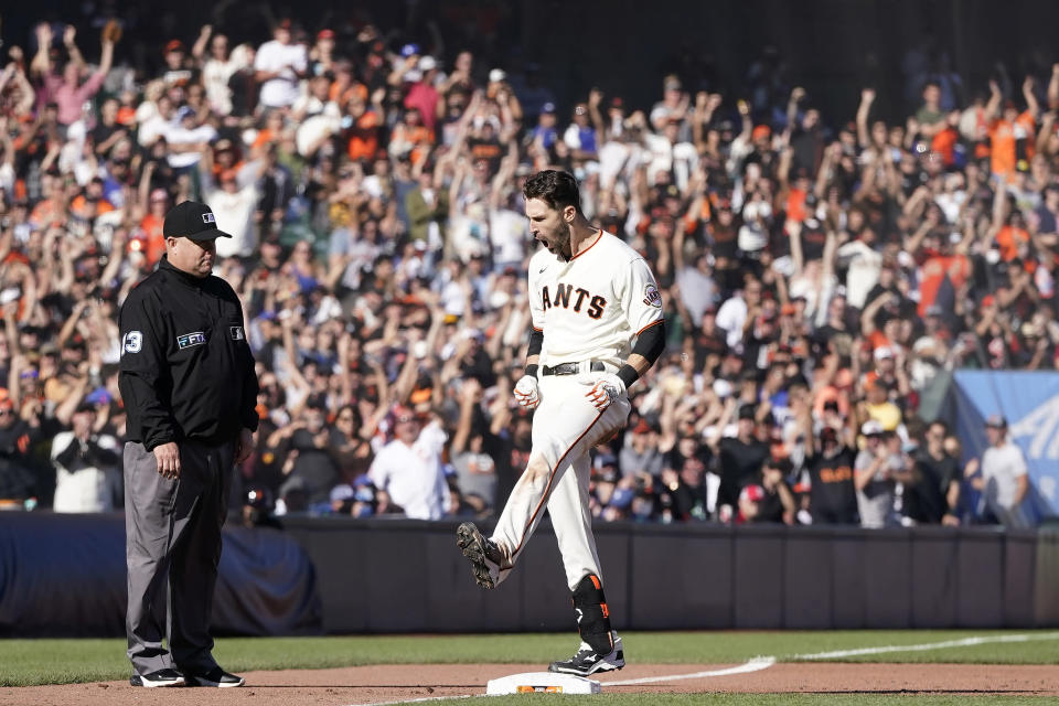 San Francisco Giants' Steven Duggar celebrates after hitting a two-run triple against the Los Angeles Dodgers during the second inning of a baseball game in San Francisco, Sunday, Sept. 5, 2021. (AP Photo/Jeff Chiu)