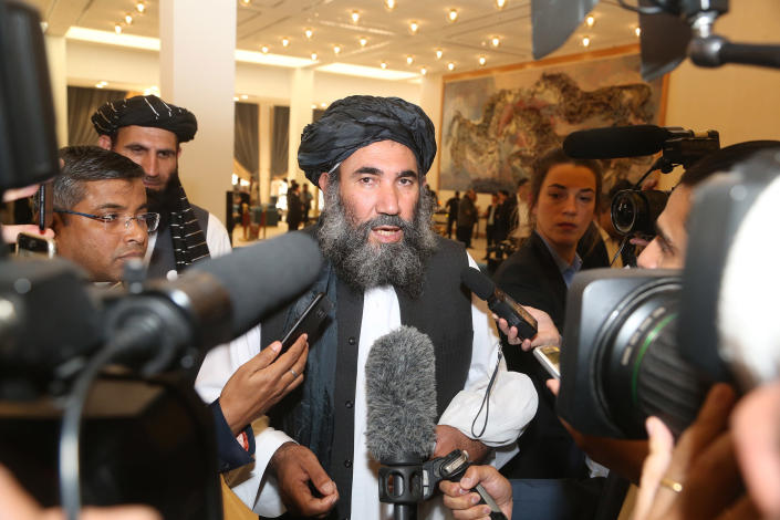 Image: Taliban leader Mullah Abdul Salam Zaeef, center, who served as ambassador to Pakistan during the Taliban's rule speaks to the media in Doha, Qatar