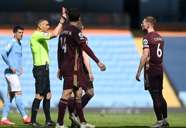 Cooper, right, was shown a straight red card in last month's win at Manchester City