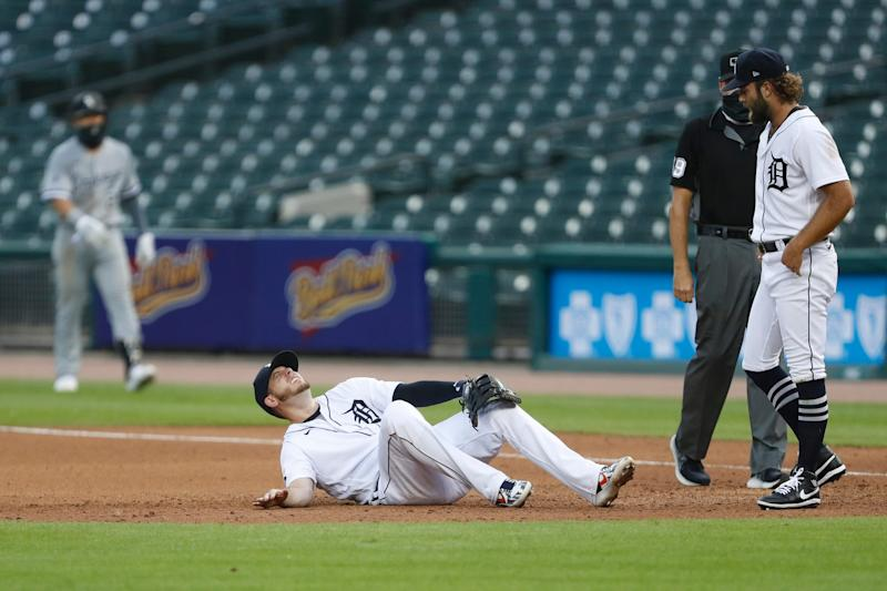 Tigers first baseman C.J. Cron goes down with a lower body injury during the fourth inning of the win over the White Sox at Comerica Park on Monday, Aug. 10, 2020.