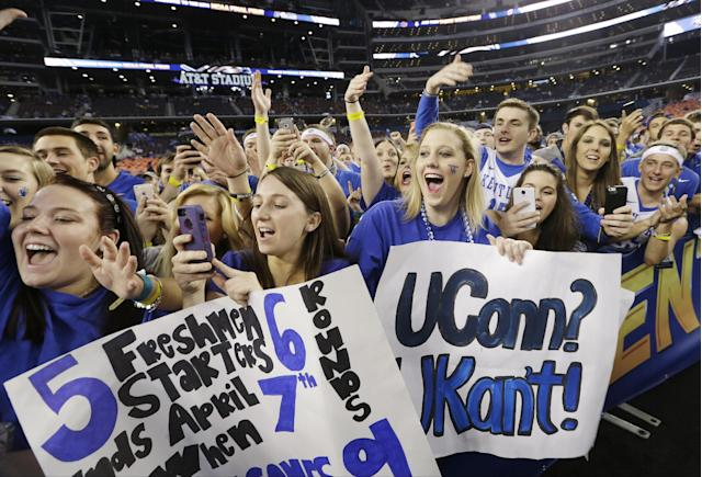 Kentucky cheer before the NCAA Final Four tournament college basketball championship game against Connecticut Monday, April 7, 2014, in Arlington, Texas. (AP Photo/David J. Phillip)