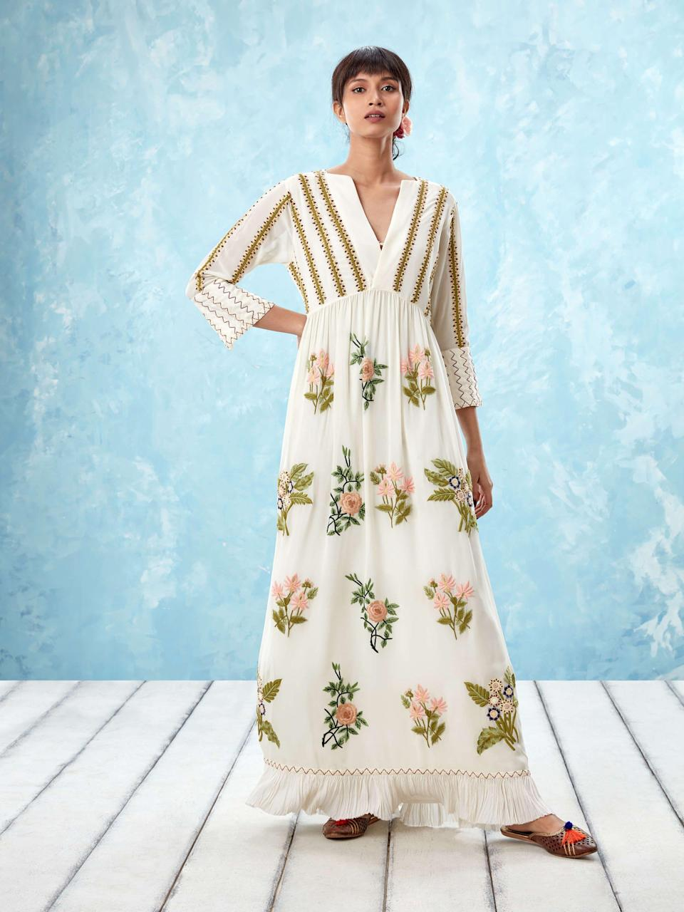 """<p>ahilaya.com</p><p><strong>$1200.00</strong></p><p><a href=""""https://www.ahilaya.com/intl/dresses/ahilaya-elizabethangardensdresswhite"""" rel=""""nofollow noopener"""" target=""""_blank"""" data-ylk=""""slk:Shop Now"""" class=""""link rapid-noclick-resp"""">Shop Now</a></p><p>""""This hand embroidered silk dress transports my imagination to a beautiful, lush garden whenever I wear it. The craftsmanship is impeccable, and the romantic features are perfect for those hot late summer days.""""—<em>Dania Ortiz, Fashion and Accessories Director</em></p>"""