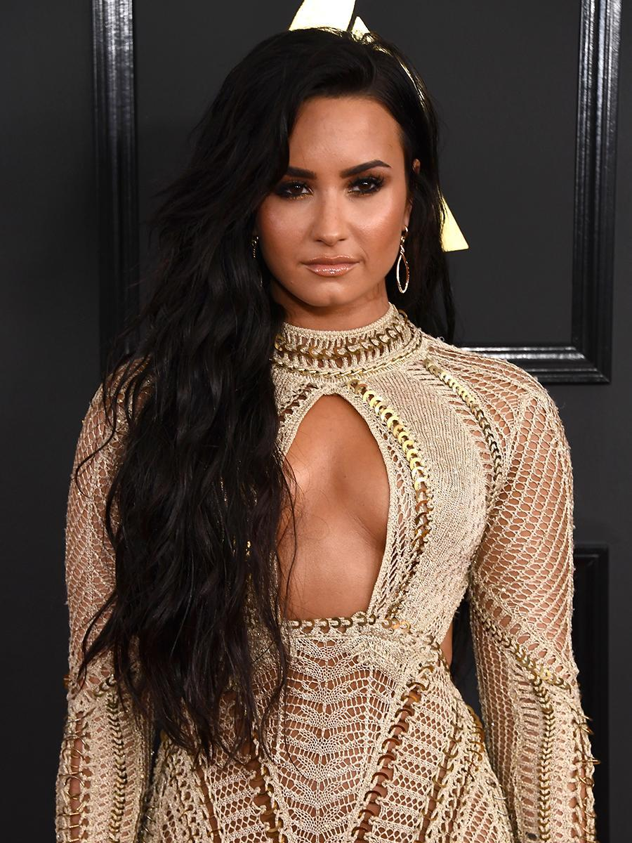 <p>The vocalist scored big beauty points with her long wavy black hair and gorgeously highlighted cheekbones. (Photo: Jon Kopaloff/FilmMagic) </p>