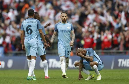 Britain Football Soccer - Arsenal v Manchester City - FA Cup Semi Final - Wembley Stadium - 23/4/17 Manchester City's Fabian Delph and team mates look dejected after the match Action Images via Reuters / Carl Recine Livepic