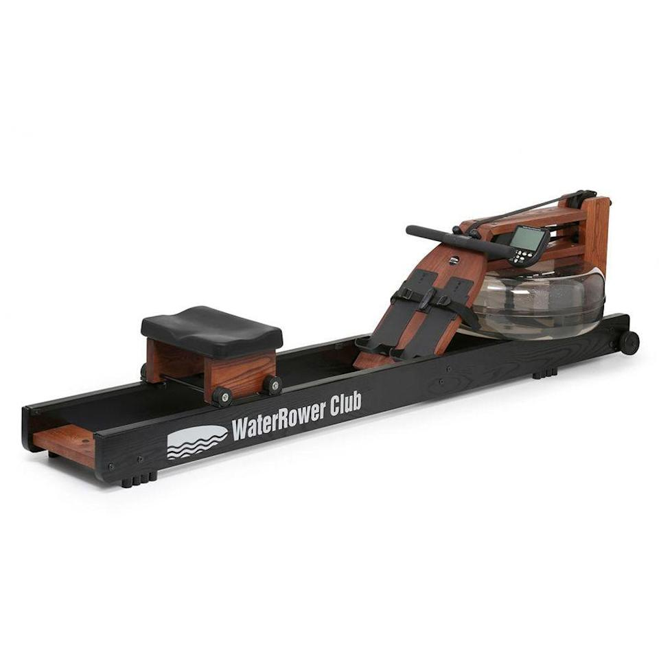 """<p><strong>WaterRower</strong></p><p>waterrower.com</p><p><strong>$1295.00</strong></p><p><a href=""""https://www.waterrower.com/ca/shop/club-rowing-machine.html"""" rel=""""nofollow noopener"""" target=""""_blank"""" data-ylk=""""slk:Shop Now"""" class=""""link rapid-noclick-resp"""">Shop Now</a></p><p>Made out of ash wood (which helps to absorb sound and vibrations, aka, it's a quiet machine) and stained in rose gold and black, this machine is as attractive as it is functional. Adjust the footpads to your size, strap your feet in, and grab the padded handle to begin rowing against water resistance. The paddle that cups the water creates a smooth stroke, so you won't experience any jerking that might happen with a rower that uses a chain. And the harder you work the more resistance or drag you'll create, meaning that you'll be pushing yourself resistance-wise.</p>"""