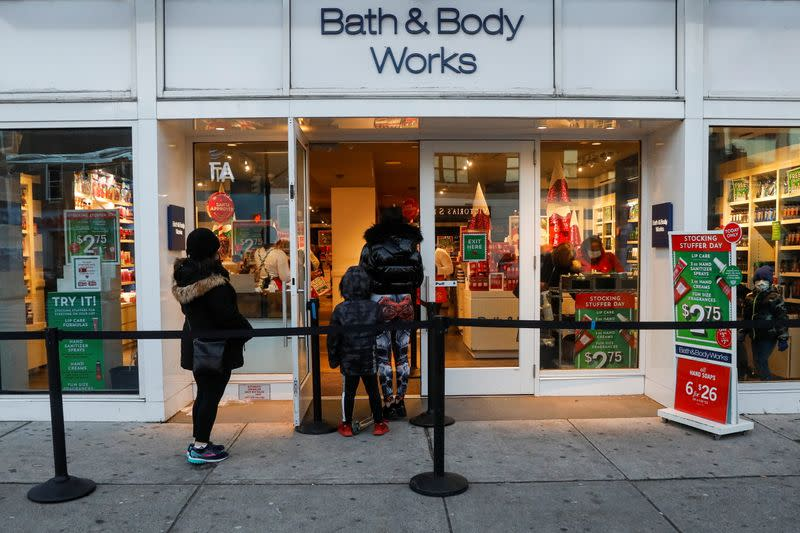 Shoppers wait in line outside a Bath and Body Works retail store, as the global outbreak of the coronavirus disease (COVID-19) continues, in Brooklyn, New York