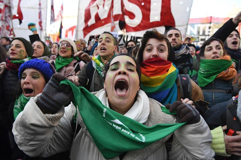 Abortion rights activists in Buenos Aires celebrate after the lower chamber of Argentina's Congress approved a bill legalizing abortion - a measure that still needs Senate approval to become law (AFP Photo/EITAN ABRAMOVICH)