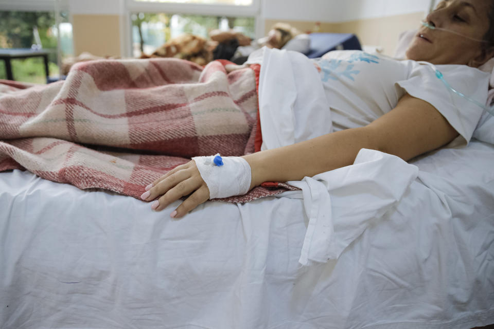 Patients lay in beds at the COVID-19 unit at the Marius Nasta National Pneumology Institute in Bucharest, Romania, Wednesday, Oct. 6, 2021. Romania is facing an accelerated increase of daily COVID-19 infections with over 14000 new cases in the last 24 hours and over 300 reported deaths, the highest ever number of fatalities in one day, as authorities report they ran out of COVID-19 ICU beds at national level. (AP Photo/Andreea Alexandru)