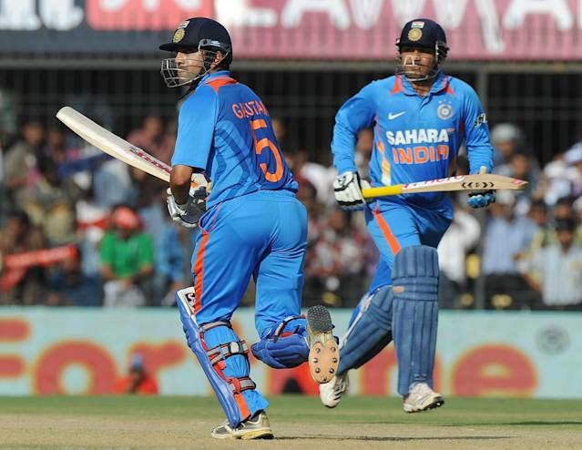 India's batsmen Gautam Gambhir (L) and Virender Sehwag run between the wickets during the fourth one-day international cricket match between India and West Indies at the Holkar Stadium in Indore on December 8, 2011. AFP PHOTO/Punit PARANJPE