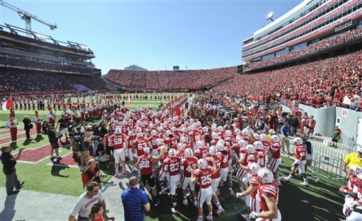Nebraska players take to the field prior to their NCAA college football game against Arkansas State in Memorial Stadium in Lincoln, Neb., Saturday, Sept. 15, 2012. (AP Photo/Dave Weaver)