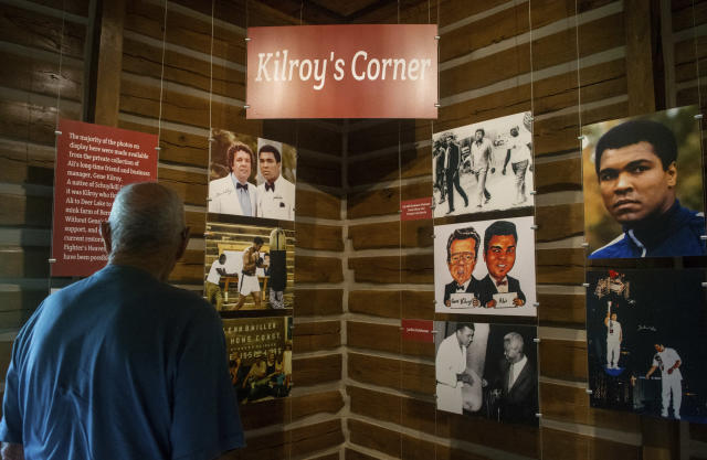 Rudy Moyer, of Cressona, Pa., looks over photos of Muhammad Ali with his business manager, Gene Kilroy, in the gym at Fighter's Heaven, Deer Lake, Pa., the former training camp of Muhammad Ali, on Friday, June 1, 2018. The event was held to commemorate the two-year anniversary of the boxing champ's passing on June 3, 2016. (David McKeown/Republican-Herald via AP)