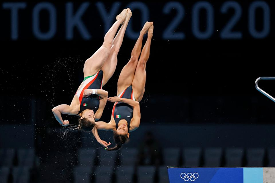 Mexico's Gabriela Agundez Garcia and Mexico's Alejandra Orozco Loza compete in the women's synchronised 10m platform diving final event during the Tokyo 2020 Olympic Games at the Tokyo Aquatics Centre in Tokyo on July 27, 2021. (Photo by Odd ANDERSEN / AFP) (Photo by ODD ANDERSEN/AFP via Getty Images)